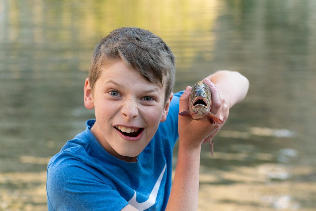 Boy with Fish in Colorado